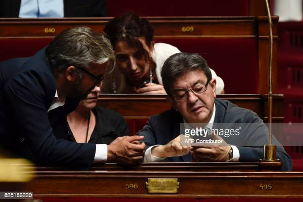 La France Insoumise leftist party's leader and parliamentary group president JeanLuc Melenchon looks at his phone during a session at the French...