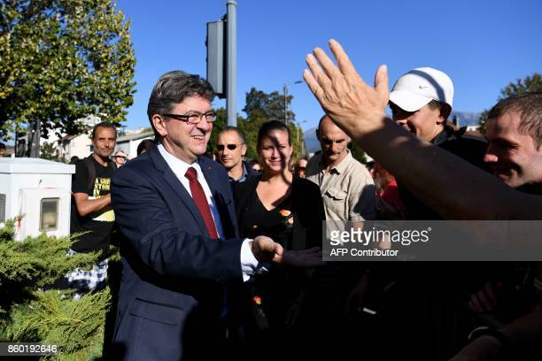 La France Insoumise leftist party's leader and parliamentary group president JeanLuc Melenchon shakes hands with employees of General Electric...