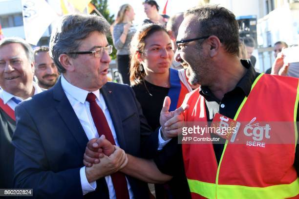 La France Insoumise leftist party's leader and parliamentary group president JeanLuc Melenchon speaks with employees of General Electric HydroAlstom...