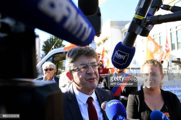La France Insoumise leftist party's leader and parliamentary group president JeanLuc Melenchon speaks to journalists after speaking to employees of...