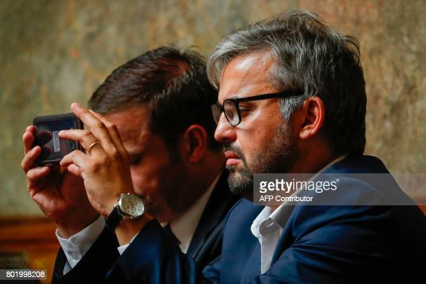 La France Insoumise leftist party's Member of Parliament at the national assembly Alexis Corbiere takes a photo with his mobile phone during the...