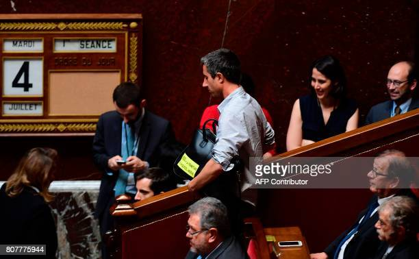 La France Insoumise leftist party's Member of Parliament Francois Ruffin holding a briefcase with a sticker reading 'No to the closing of the Amiens...
