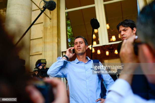 La France Insoumise leftist party's member of parliament Francois Ruffin speaks on his mobile phone as he arrives at the French National Assembly on...