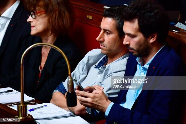 La France Insoumise leftist party's Members of Parliament Francois Ruffin and Bastien Lachaud listen to the speeches of parliamentary groups...