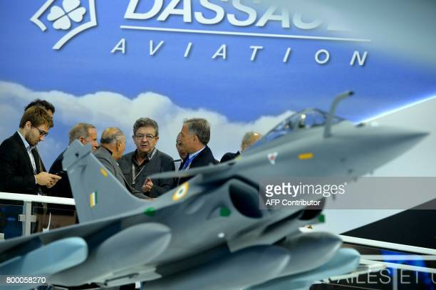 La France Insoumise leftist party's members of parliament party leader JeanLuc Melenchon talks with Chairman of Dassault Group Serge Dassault and...