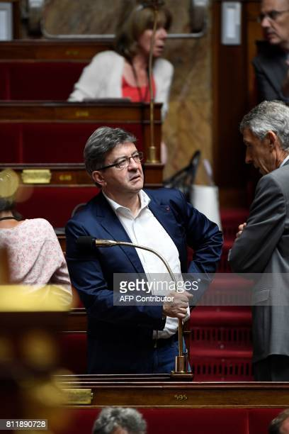 La France Insoumise leftist party's parliamentary group president JeanLuc Melenchon speaks to Corsican Member of Parliament Michel Castellani on July...