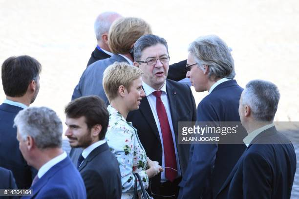 La France Insoumise leftist party's parliamentary group president JeanLuc Melenchon speaks with MP Clementine Autain ahead of the start of the annual...
