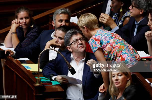 La France Insoumise leftist party's parliamentary group president JeanLuc Melenchon speaks with MP Clementine Autain during a session of questions to...