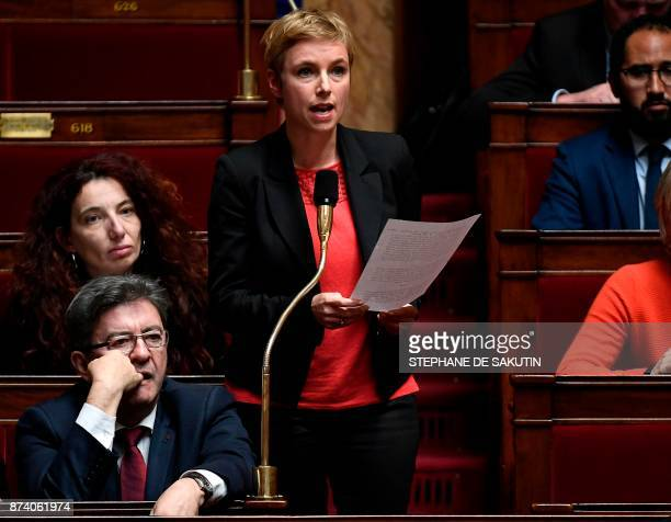 La France Insoumise member of Parliament Clementine Autain speaks as France Insoumise Leader JeanLuc Melenchon reacts next to her during a session of...