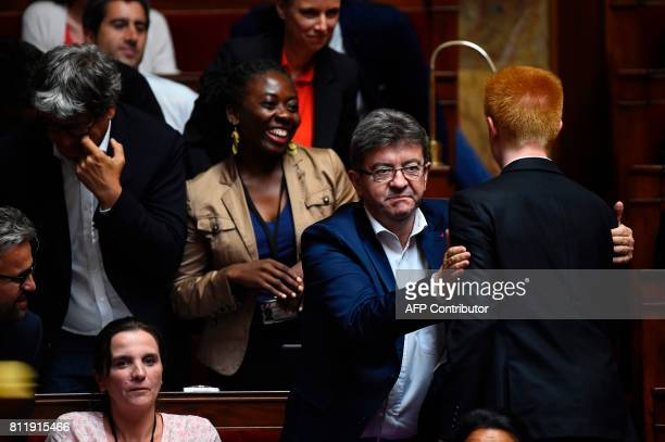 La France Insoumise party's member of Parliament Adrien Quatennens is congratulated by LFI member of Parliament JeanLuc Melenchon after delivering a...