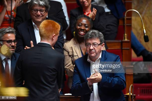 La France Insoumise party's member of Parliament Adrien Quatennens speaks with LFI member of Parliament JeanLuc Melenchon after delivering a speech...