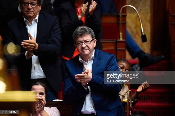 La France Insoumise party's member of Parliament JeanLuc Melenchon applauds during a debate on July 10 2017 at the French National Assembly in Paris...