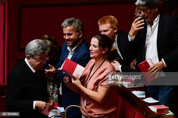 La France Insoumise party's Members of Parliament Mathilde Panot Alexis Corbiere Caroline Fiat Adrien Quatennens Daniele Obono and Eric Coquerel hold...
