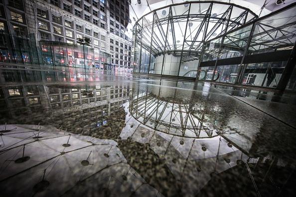 La Grande Arche de la Defense reflecting into a puddle on February 13 2016 in Paris La Defense France