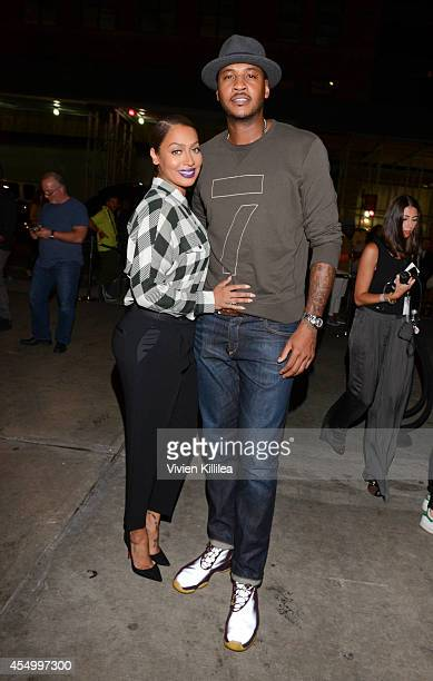 La la Anthony and basketball player Carmelo Anthony arrive at the rag bone fashion show during MercedesBenz Fashion Week Spring 2015 at Skylight at...