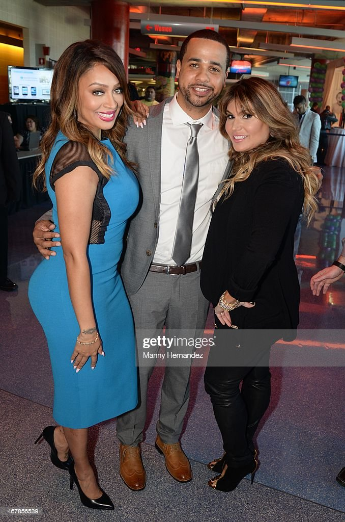 La La Anthony, Christian Vazquez and Loren Ridinger at the 2014 Market America World Conference at American Airlines Arena on February 8, 2014 in Miami, Florida.