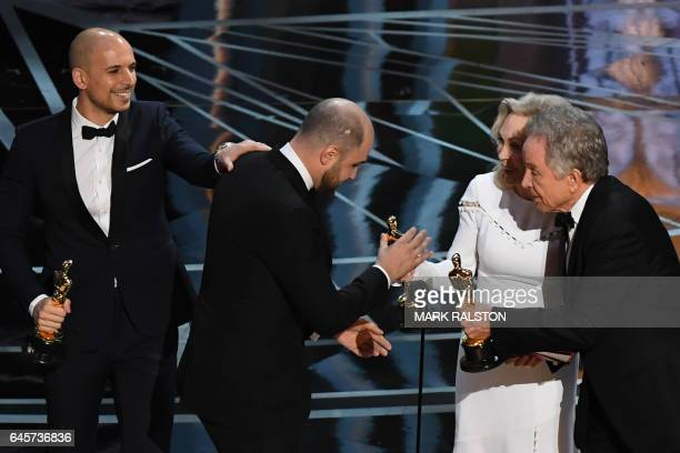 TOPSHOT 'La La Land' producer Jordan Horowitz accepts his award for best picture from US actors Faye Dunaway and Warren Beatty next to producer fred...