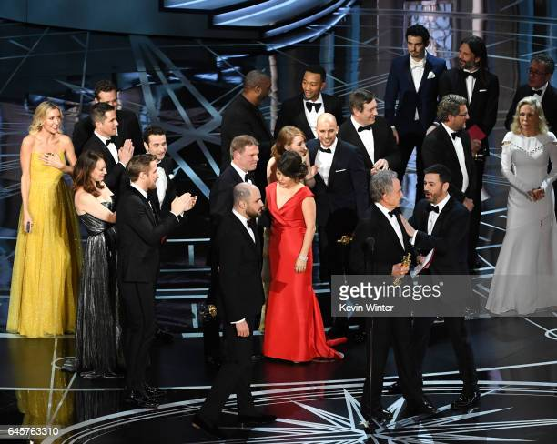 'La La Land' producer Jordan Horowitz actor Warren Beatty and host Jimmy Kimmel stop the show to announce the actual Best Picture winner as...