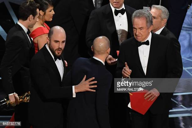 'La La Land' producer Jordan Horowitz celebrates next to US actor Warren Beatty after the latter mistakingly read 'La La Land' initially instead of...