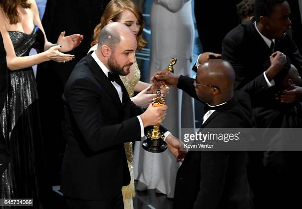 ''La La Land' producer Jordan Horowitz hands over the Best Picture award to 'Moonlight' writer/director Barry Jenkins following a presentation error...