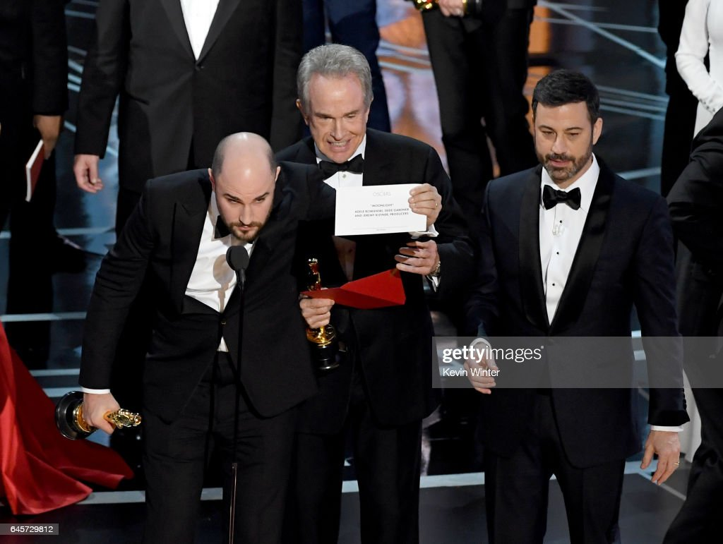 'La La Land' producer Jordan Horowitz holds up the winner card reading actual Best Picture winner 'Moonlight' with actor Warren Beatty and host Jimmy Kimmel onstage during the 89th Annual Academy Awards at Hollywood & Highland Center on February 26, 2017 in Hollywood, California.
