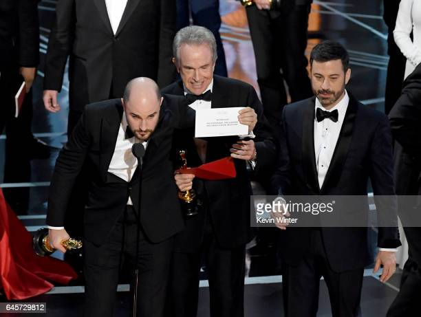 'La La Land' producer Jordan Horowitz holds up the winner card reading actual Best Picture winner 'Moonlight' with actor Warren Beatty and host Jimmy...