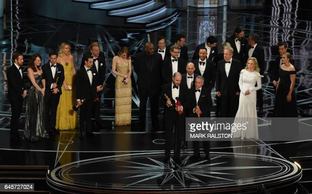 'La La Land' producer Jordan Horowitz speaks while holing an oscar and the winner card before reading the actual Best Picture winner 'Moonlight'...