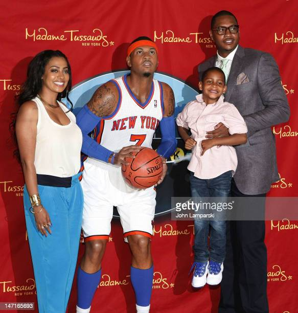 La La Vazquez Anthony Kiyan Anthony and Carmelo Anthony attend the Carmelo Anthony wax figure unveiling at Madame Tussauds on June 26 2012 in New...