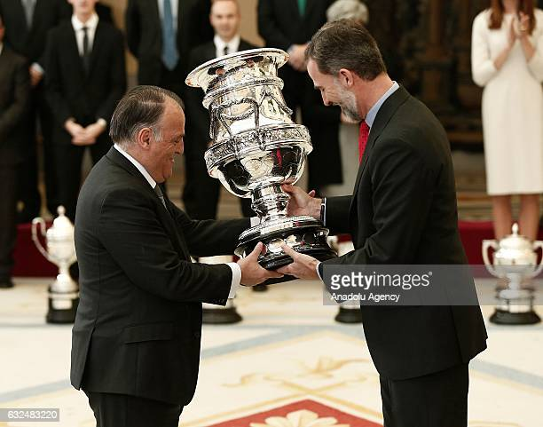 La Liga president Javier Tebas receives his award from King Felipe VI of Spain during the National Sports Awards 2015 ceremony at the El Pardo Palace...