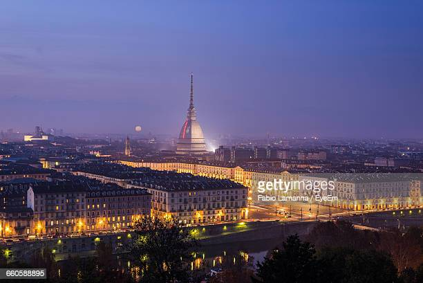 La Mole Antonelliana In Illuminated City Against Sky At Dusk