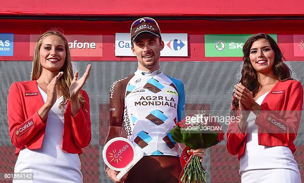 La Mondiale's French cyclist Pierre Latour celebrates on the podium after winning the 20th stage of the 71st edition of 'La Vuelta' Tour of Spain a...