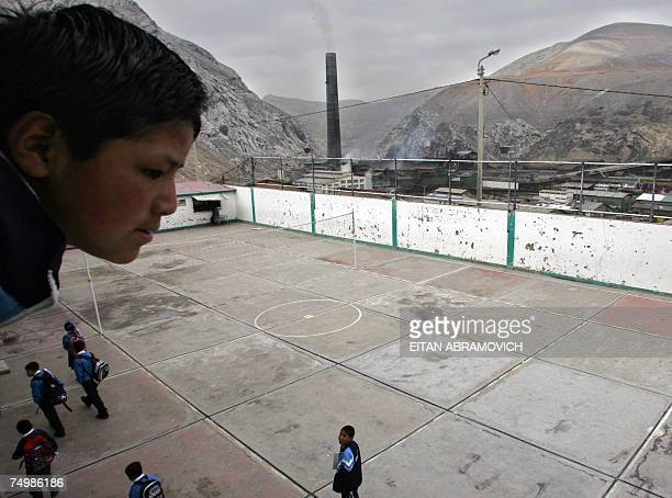 A student observes the playground from a balcony of his school in La Oroya more than 150 km east of Lima on May 31st next to the smelter La Oroya...