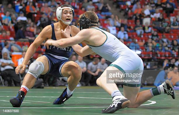 La Plata's Josh Lopez eludes the lunge of Tuscarora's Matt Wax and winds up winning the 152 pound weight class during the Maryland State Wrestling...
