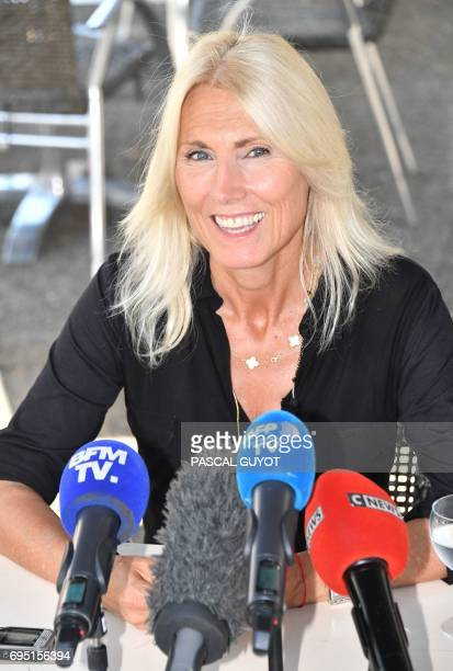 La Republique en marche party's candidate for the upcoming legislative elections in the Gard second constituency Marie Sara speaks to journalists...