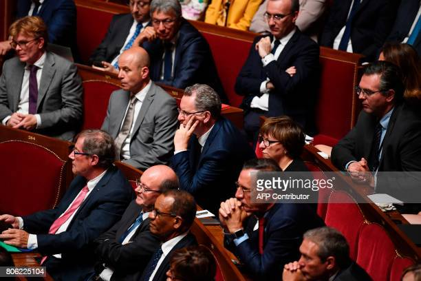 La Republique En Marche party's group president at the French national assembly Richard Ferrand listens to French President's speech during a special...