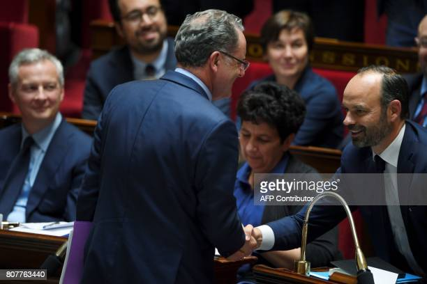 La Republique En Marche party's group president at the French national assembly Richard Ferrand shakes hand with French Prime Minister Edouard...