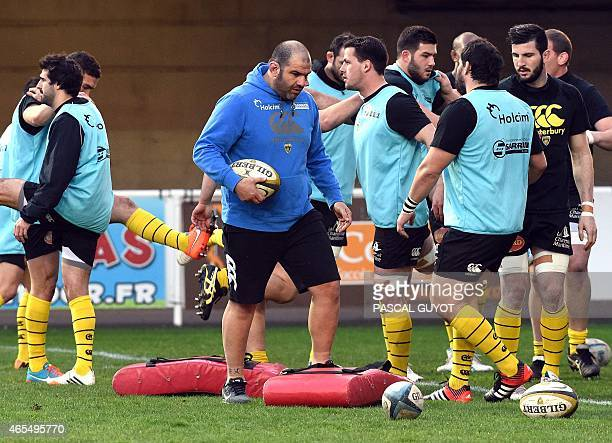 La Rochele's players with their head coach Patrice Collazo warm up prior to the start of the French Top 14 rugby union match between Montpellier and...