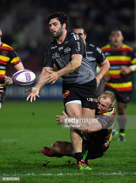 La Rochelle player Kevin Gourdon offloads despite the tackle of Matt Kvesic of Gloucester during the European Rugby Challenge Cup match between...