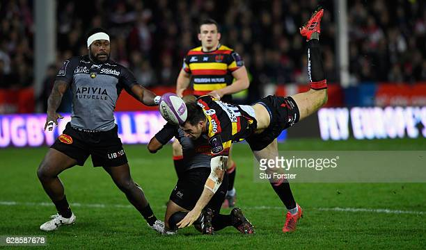 La Rochelle player Ricky Januarie tackles Mark Atkinson of Gloucester during the European Rugby Challenge Cup match between Gloucester Rugby and...