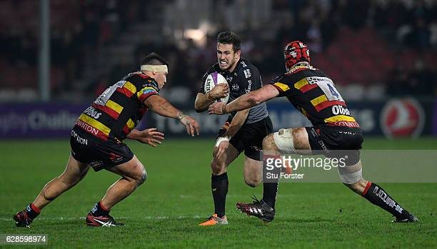 La Rochelle player Zack Holmes tries in vain to escape the clutches of Tom Savage and Josh Hohneck of Gloucester during the European Rugby Challenge...