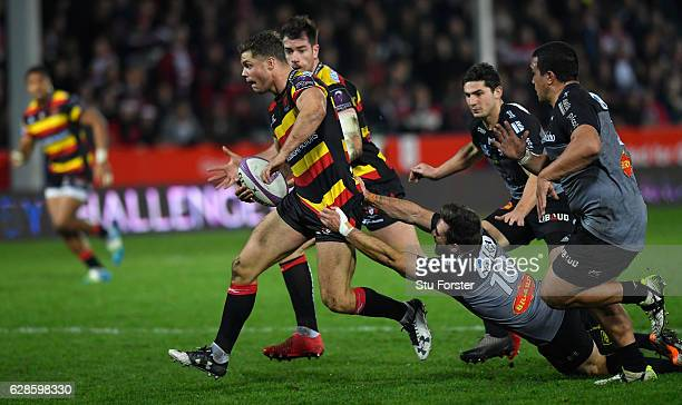 La Rochelle player Zack Holmes tries in vain to stop the run of Henry Purdey of Gloucester during the European Rugby Challenge Cup match between...
