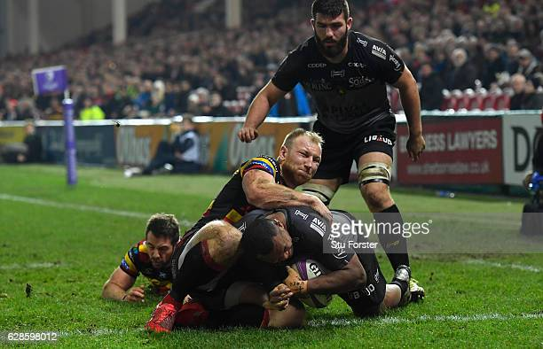 La Rochelle winger David Raikuna scores the second try for the visitors despite the attentions of Matt Kvesic during the European Rugby Challenge Cup...