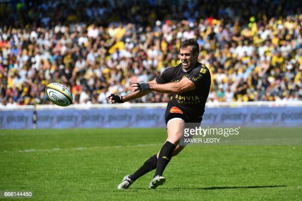 La Rochelle's Australian flyhalf Brock James passes the ball during the French Top 14 rugby union match between La Rochelle and BordeauxBegles on...