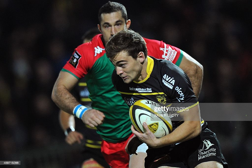 La Rochelle's Charles Bouldoire runs with the ball during the French Top 14 rugby union match La Rochelle vs Bayonne on November 29 2014 at the...