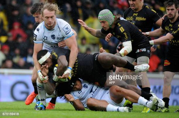 La Rochelle's Fidgian center Levani Botia is tackled during the French Top 14 rugby union match between La Rochelle and Montpellier on april 30 2017...