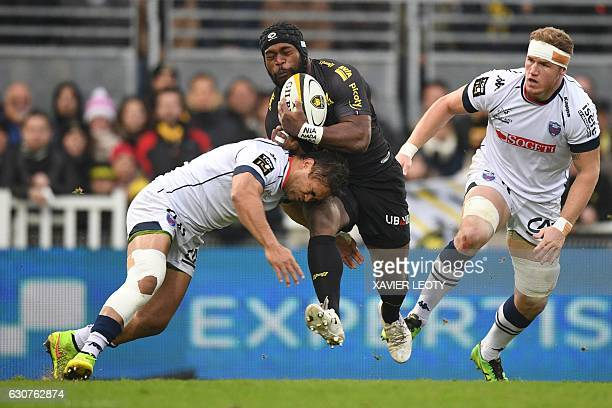 La Rochelle's Fijian centre Levani Botia runs with the ball during the French Top 14 rugby union match between La Rochelle and Grenoble at Marcel...