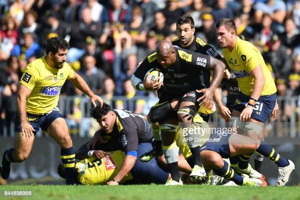 La Rochelle's Fijian lock Jone Qovu runs with the ball during the French Top 14 rugby union match between La Rochelle and Clermont on September 9...