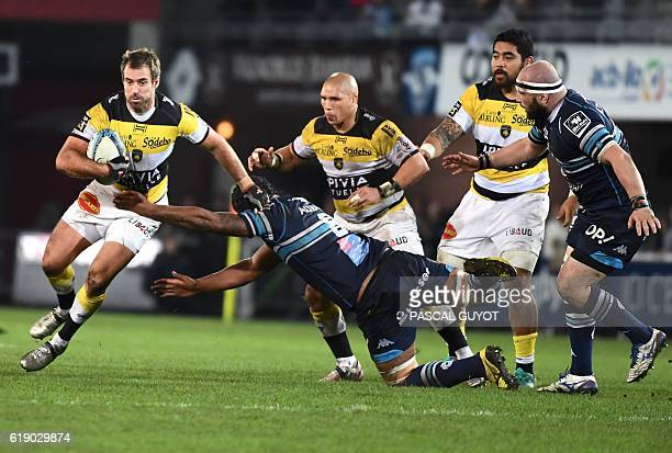 La Rochelle's French Arthur Retiere vies with Montpellier's Fijian flanker Akapusi qera during the French Top 14 rugby union match between...