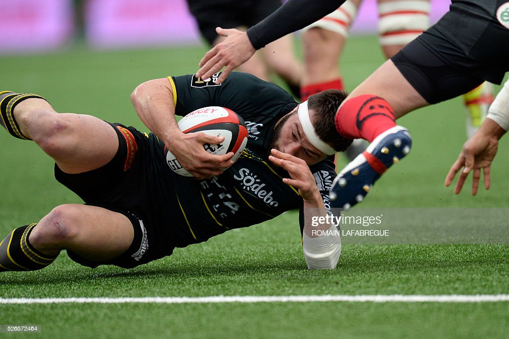 La Rochelle's French center Pierre Aguillon falls before scoring a try during the French Top 14 Rugby Union match between Oyonnax and La Rochelle on April 30, 2016 at the Charles-Mathon stadium in Oyonnax, central-eastern France. / AFP / ROMAIN