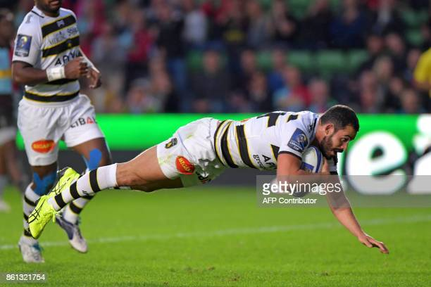 La Rochelle's French centre Geoffrey Doumayrou dives over the line to score a try during the European Rugby Champions Cup rugby union round 1 pool...